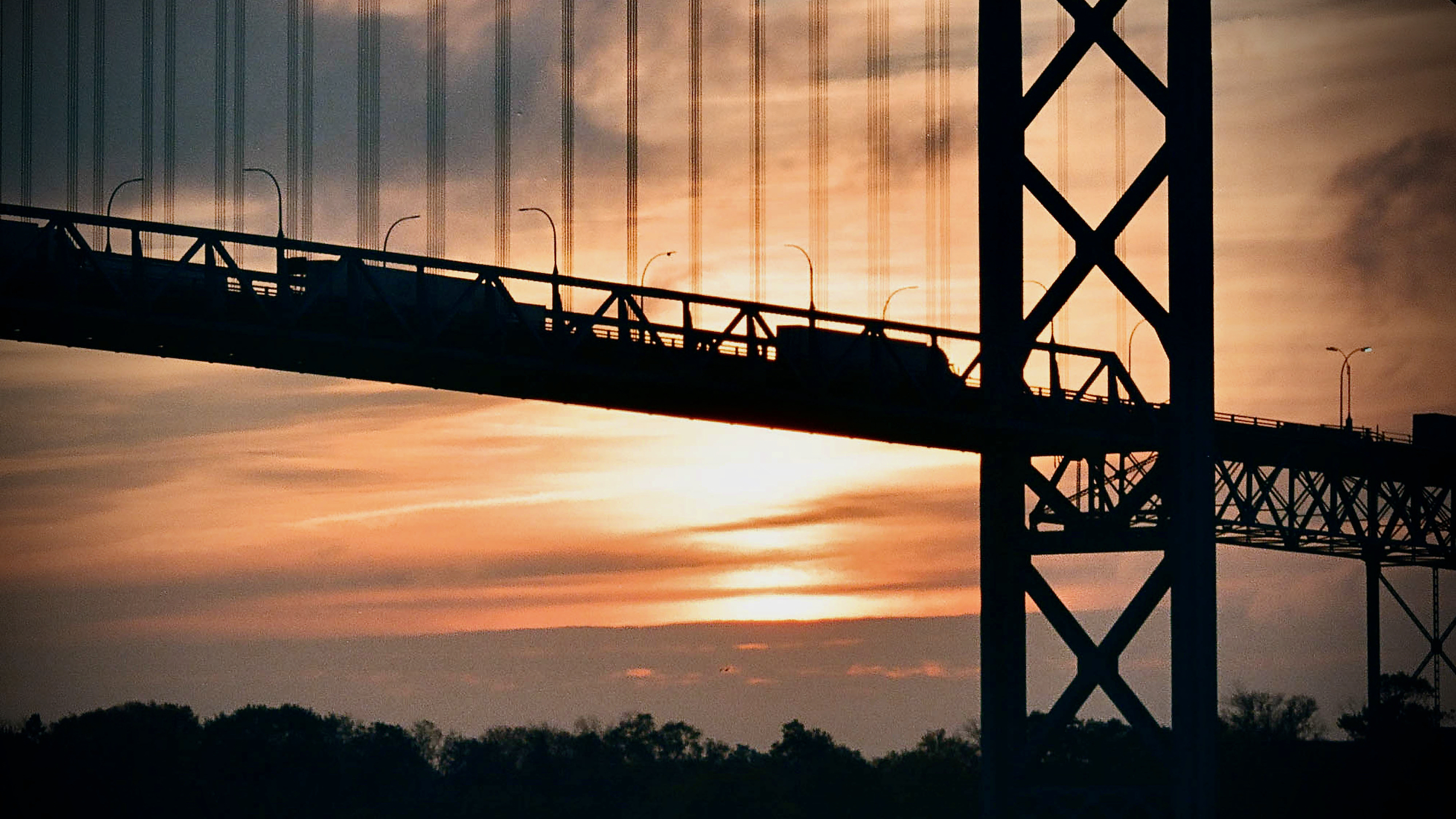 Trucks drive on the Ambassador Bridge, between Detroit and Windsor, at the U.S.-Canada border, which closed on Sept. 11, 2001.