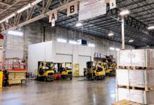 Inside an airfreight warehouse, with forklifts parked.