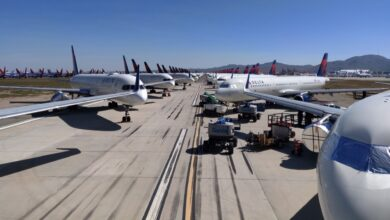 Delta aircraft stored wing-to-wing on an airfield.