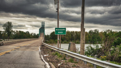A photograph of a rural highway crossing the Mississippi River.