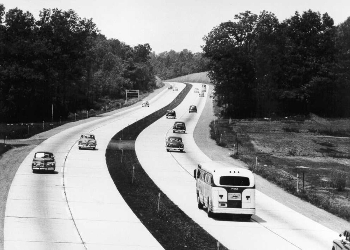 Cars and a bus move along the Turnpike in an earlier, less busy time. (Photo: Pennsylvania Turnpike Commission)