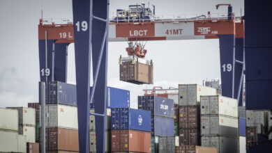 Rail-mounted gantry cranes cull container stacks at the Port of Long Beach.