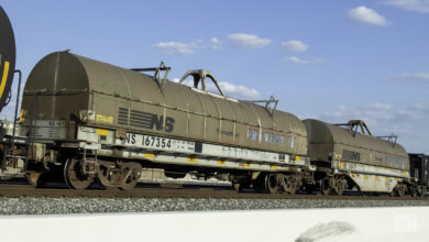 A photopgraph of tank cars parked in a rail yard.