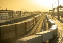 Sunset on a big container rail yard.