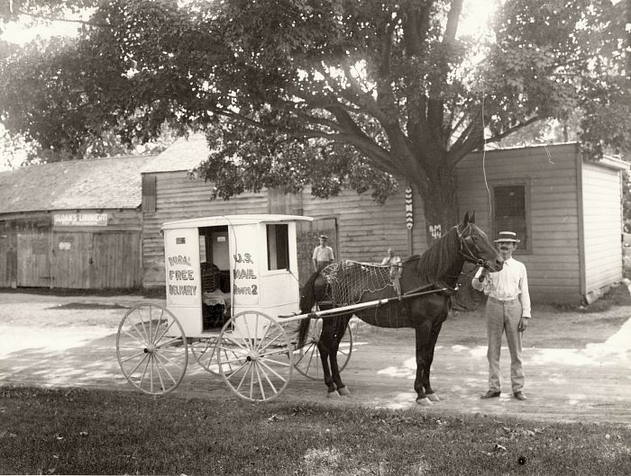 One of the first RFD carriers, his cart and his horse.  (Photo: National Postal Museum / Smithsonian Institution)