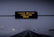 """""""Winter Driving Conditions Ahead"""" road sign."""