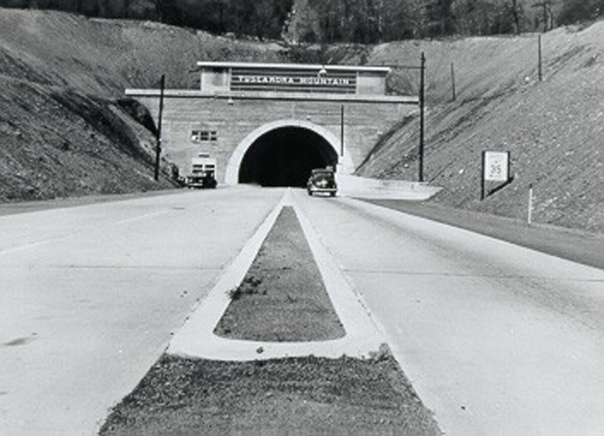 The Tuscarora Mountain Tunnel. The automobile entering the tunnel is in a single lane; on the other side of the tunnel the single lane expands to two lanes at the tunnel exit. (Photo: Pennsylvania Turnpike Commission)