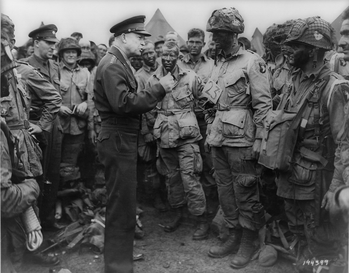 General Eisenhower speaks with men of the 101st Airborne Division, who jumped into France on the night before D-Day.  (Photo: United States European Command)