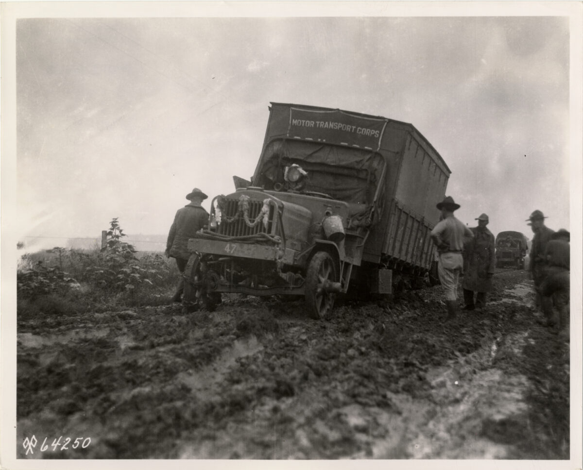 Dealing with mud was just one of the convoy's issues along its route. (Photo: Detroit Library Digital Collection)