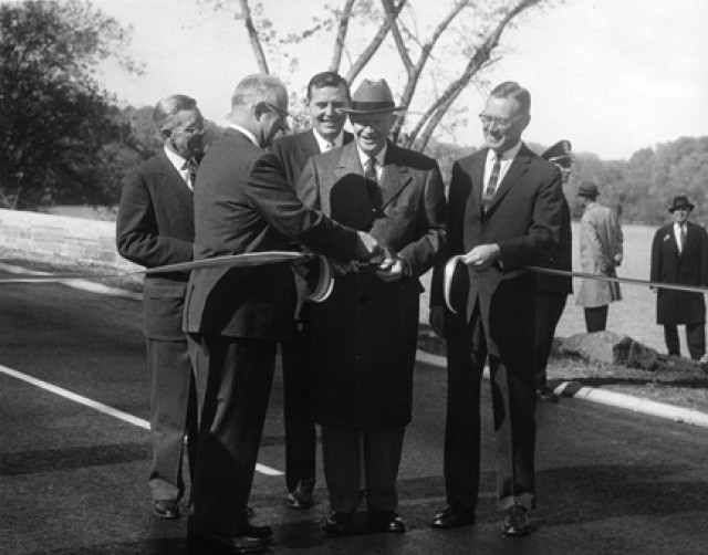 President Eisenhower cuts the ribbon, opening a section of the U.S. Interstate Highway System.  (Photo: U.S. Army)