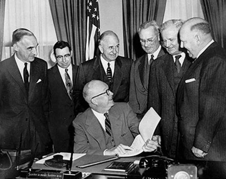 President Eisenhower signs the Federal Highway Act of 1956, authorizing the construction of the Interstate Highway System. (Photo: Federal Highway Administration)