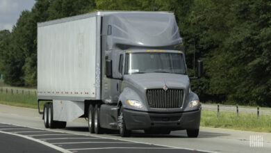 A Navistar International truck travels on a road, illustrating an article about a lawsuit over a data breach at the company.